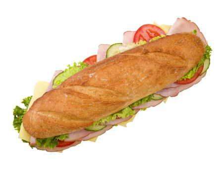 top: Foot-long submarine sandwich with ham, swiss cheese, lettuce, tomatoes and cucumbers. Top view, isolated on white