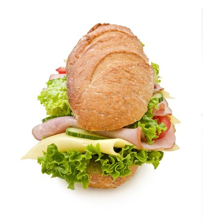 Extra large 12inch submarine sandwich with ham, swiss cheese, lettuce, tomatoes and cucumbers isolated on white