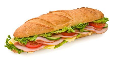 sub: Foot-long submarine sandwich with ham, swiss cheese, lettuce, tomatoes and cucumbers. Top view, isolated on white