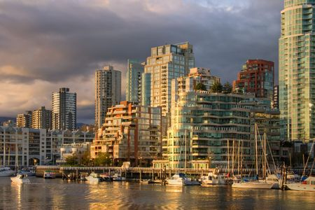 Vancouver at dusk - view from Granville Island at downtown condominiums