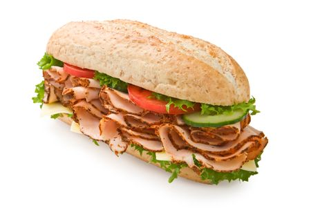 sub: Large multi-grain turkey submarine sandwich with lettuce, tomatoes and cheese Stock Photo