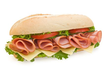 Ham & swiss cheese submarine sandwich on white bread with lettuce and tomatoes, isolated on white