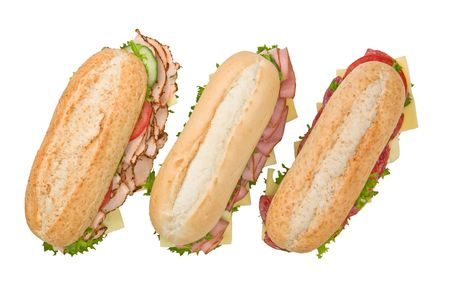 Three fresh submarine sandwiches isolated on white background: salami, turkey and ham photo