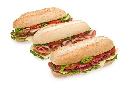 Trio of fresh submarine sandwiches on white background - salami, ham and turkey photo