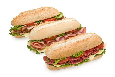 Trio of fresh submarine sandwiches on white background - salami, ham and turkey photo