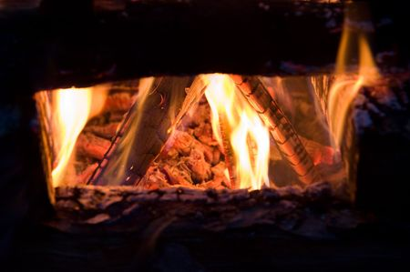outdoor fireplace: Wood burning inside of a campfire