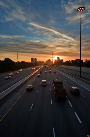 rush hour: The beginning of morning rush hour, cars on the highway traveling to and from  downtown Stock Photo