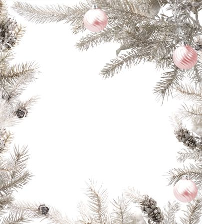 silver background: Branches of a silver Christmas tree arranged with baubles to create a frame Stock Photo