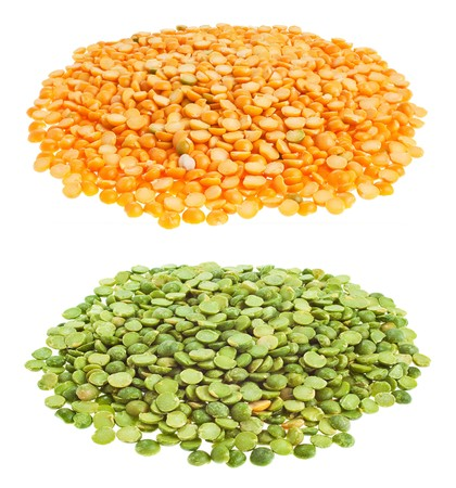 Dry yellow and green split peas on white background