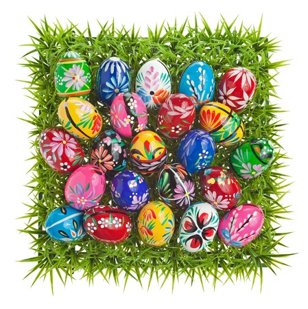 Wooden painted Easter eggs arranged on a grass square photo