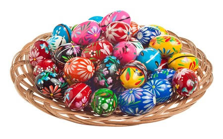 tradition: Colorful hand painted Easter Eggs in a wicker bowl Stock Photo
