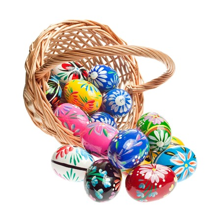 Basket with Easter Eggs on white background photo