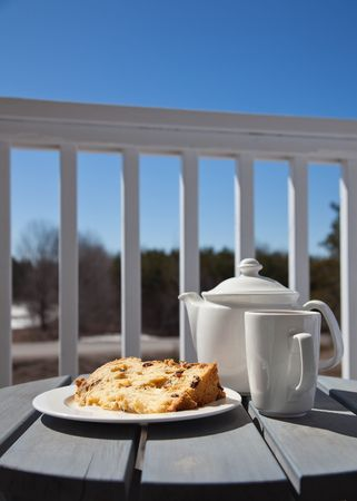 Slice of Panettone with a cup of tea served outdoors photo