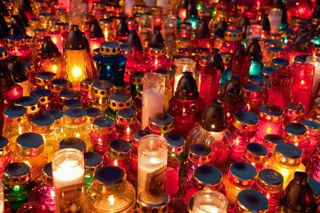 christian halloween: Hundreds of memorial candles shining at the cemetery on the All Saints Day Day (November 1st)