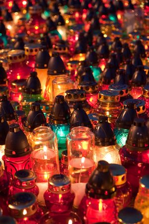 all saints  day: Memorial candles shining at the cemetery on the All Saints Day Day (November 1st)
