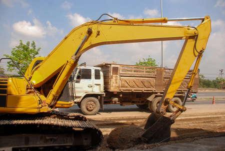 Yellow excavator digging excavator machine working