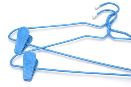 clost up shot of two plastic hangers