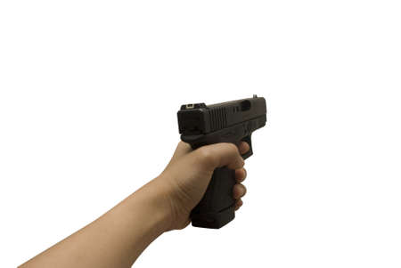 a girl holds a black handgun with left hand on white background Stock Photo