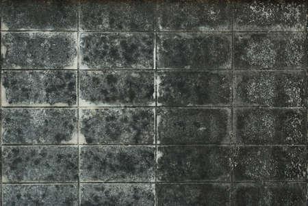 Dirty wall background. dark bricks. Stock Photo
