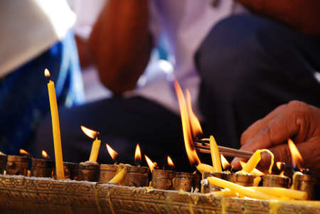 candle flame at Buddhist temple