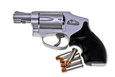 Modern ultra light weight titanium 5 shot revolver with live jacketed hollow point ammo photo