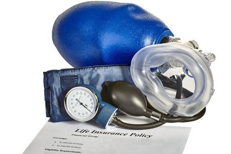 medical ventilator: Emergency medical blood pressure monitor with CPR artificial ventilator mask and life insurance policy on white background.