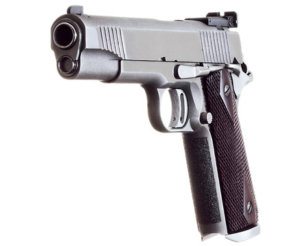 45 caliber: 45 Caliber custom match grade stainless steel automatic pistol on white background Stock Photo