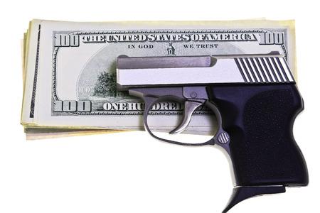 semi automatic: 32 caliber stainless steel semi automatic pistol guarding American Money