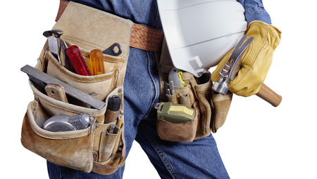 Contractor Man With Carpenter Toolbelt and Hammer Isolated on White Background photo