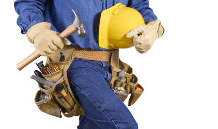 Contractor Man With Carpenter Toolbelt and Hammer Walkingl Isolated on White Background photo