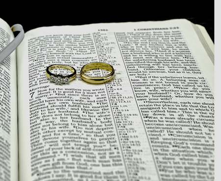 isaiah: Closeup of Bible and Wedding Rings Corinthians on Marriage
