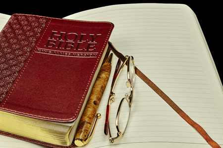 isaiah: Bible personal journal pen glasses Stock Photo