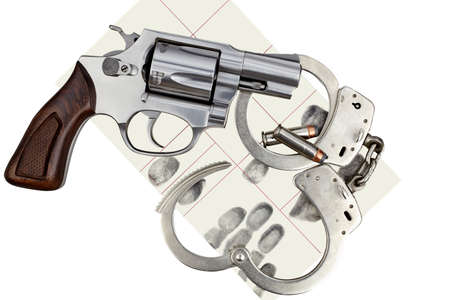 restraints: Gun with handcuffs and fingerprint ID for criminal arrest