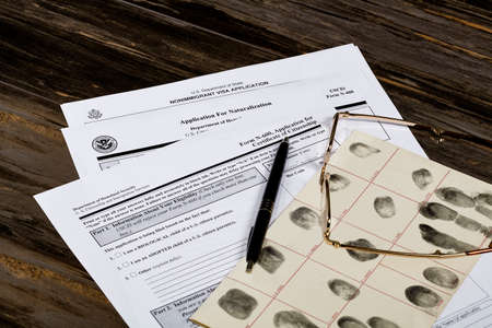 unlawful act: USA America Citizenship Application with glasses