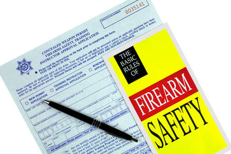 permit: Concealed Weapon Permit Application and Safety  Brochure Stock Photo