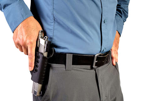 and carry on: Law Enforcement Professional Man with Holstered Gun Weapon Stock Photo