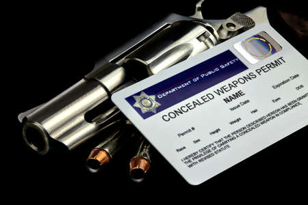 concealed: Revolver and Bullets and Concealed Weapon Permit