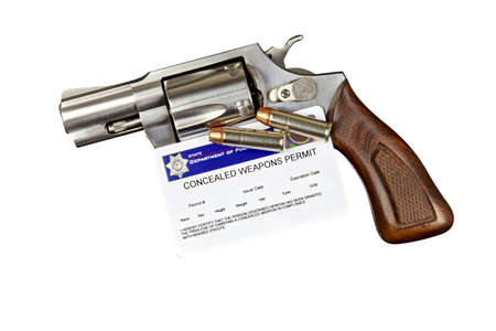 permit: Gun with Bullets and Concealed Weapon Permit on White Stock Photo