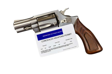 concealed: Gun with Concealed Weapon Permit Isolated on White
