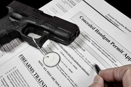 38 caliber: Man with gun and permit application documents Stock Photo