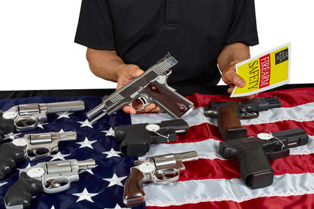 38 caliber: Man with guns for sale with safety brochure on USA America Flag