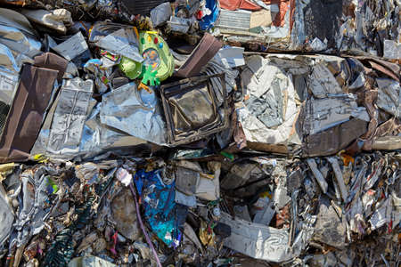 compacted: Metal scrap garbage compacted for recycling