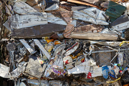 compacted: Scrap Metal Waste Compacted for Recycling Stock Photo