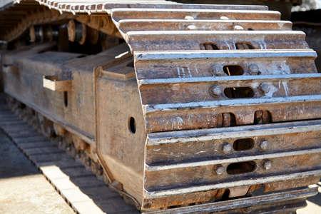 heavy: Heavy equipment excavator tracks closeup Stock Photo