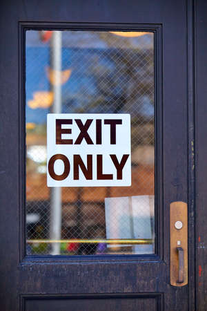 at sign: exit only sign signage Stock Photo
