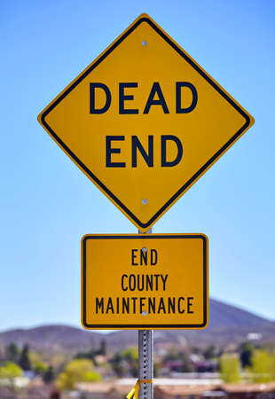 dead end: street sign dead end no county maintenance blue sky