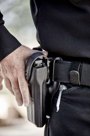 sidearm: police law enforcement guard on patrol in uniform with guns Stock Photo
