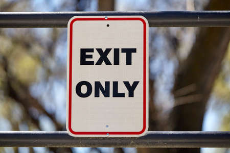 signage: exit only sign signage Stock Photo