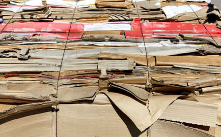 compacted: Compacted carboard waste for recycling industry Stock Photo