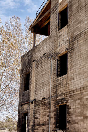 mva: structure building burned by fire